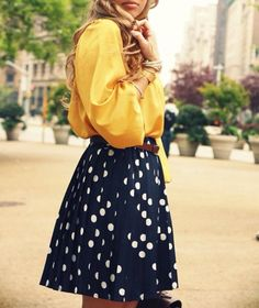 Sweet and sophisticated: Yellow blouse with navy and white polka dot skirt.