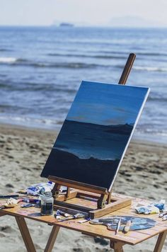 Use a little wooden fold out table for the beach for pochade box painting.
