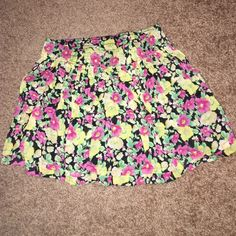 Floral Forever 21 skirt Yellow, pink, green and black floral skirt. Has black inside lining. From forever 21 and a size large. Forever 21 Skirts Mini
