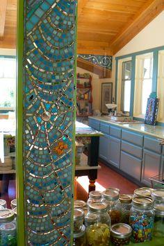Spider web mosaic between windows inside studio.