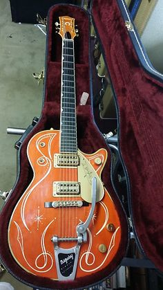 2005 Gretsch 6121 semi-hollow solid body.Pinstriped by Hot Rod Walt in 2015.Check out his youtube video !!!Gretsch Orange with gold hardware.Filtertron Pickups.3 way pickup switch, 3 way tone switch, individual pickup volumes.Factory Bigsby.Original Gretsch hardcase and paperworkEmail for shippin...