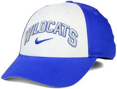 Celebrate a long tradition of greatness in the classic Kentucky Wildcats NCAA L91 Verbiage Swoosh cap. This simple, multi-color cap features your favorite college team's name in raised letters, and the single word is arched around a classic Nike swoosh. Mid crown Structured fit Normal bill Raised embroidered team name at front Nike swoosh logo at front Flat embroidered team logo at back Stretch fitted Cotton/spandex Spot clean only