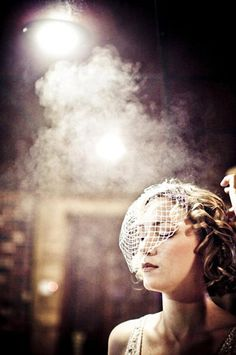 love the birdcage veil and the classic feel of the photo