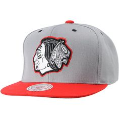 Show some love for Chi Town in the Chicago Blackhawks Arch Undervisor snapback hat from Mitchell and Ness. The Chicagoz Blackhawks snapback from the originators in throwback gear will quickly be your favorite snapback hat. Grey, white, and grey two-tone Blackhawks logo with a red bill, button, and snapback make this grey flat billed hat any true fan's style.