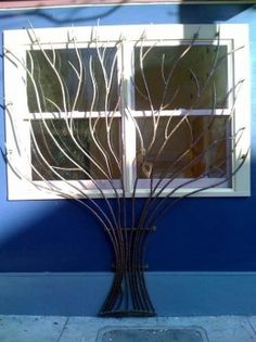 Decorative window bars for security and looks.  Includes article on other types of window bars.