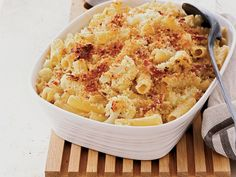 Parmigiano-Crusted Rigatoni with Cauliflower and Prosciutto | Food & Wine goes way beyond mere eating and drinking. We're on a mission to find the most exciting places, new experiences, emerging trends and sensations.