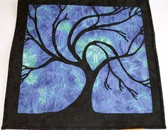 One of Scott's favorite tree quilts . . . I'd love to attempt this in green and browns.  I think this pattern uses applique in reverse (the blue) on black, instead of appliquing the tree on the quilt.