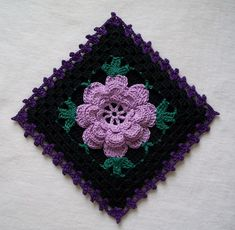 An interesting take on an old favorite. NEW thread crochet flower potholder with gothic touches, crocheted from vintage 1950's pattern. Black thread with large lavender Irish crochet rose. Green accents and purple edging.   Square, measures six inches across. Loop on back for hanging. Crocheted with #10 crochet cotton and steel hook.