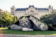 """Popped Up"", a public sculpture in Budapest by Ervin Loránth Hervé of http://www.herveart.com description at link (h/t BoredPanda) ""Artist Ervin Loránth Hervé created an impressive sculpture called ""Popped Up"" that depicts a giant man crawling out of the earth. The polystyrene sculpture is located at Széchenyi Square in Budapest, Hungary, and was one of the highlights for the Art Market Budapest 2014 international contemporary art fair."""