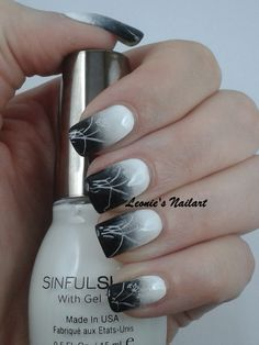 #31dc2 Day 5: Black and White I did a gradient from white to black with a white flower-stamp. White: China Glaze White on White (also for stamp) Black: Catrice Black to the Routes  Grey: Catrice London's Weather Forecast  Topcoat: Seche Vite Leonie's Nailart