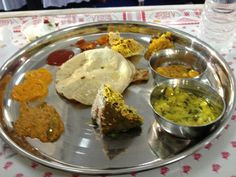 Traditional Indian, Jain thali- no onions,ginger or garlic in any of the curries. Extreme right is a creamy cashew curry that I tasted for the first time! Yum !