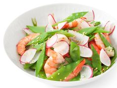 Ellie uses pre-cooked shrimp to make this Asian-inspired Shrimp and Snow Peal Salad super fast.