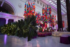 Hanging palm leaves - The Field Museum's Women's Board Gala Corporate Event Planner, Corporate Gifts, Corporate Events, Stage Design, Event Design, Field Museum, Event Decor, Gala Decor, Ceiling Decor