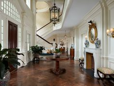 grand entry.  a bit too voluminous for me, but lovely.  not sure if i like the fireplace in the entry...