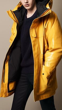 Burberry Brit Amber Yellow Seam-Sealed Rubberised Cotton Parka - A hooded parka in weatherproof rubberised cotton.  The oversize design features drawcords at the hood, waist and hem, and graphic Velcro strips at the placket and cuff tabs. Discover the men's outerwear collection at Burberry.com