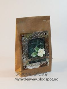 "One of 24 Mixed Media Kraft bags for an advent calendar. Created as a DT for Hobbykunst, Embossed metal tape, distress ink powder and ""snake skin"" effect (Andy Skinner). Made by Kirsten Hyde."