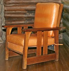 """Stickley #2341 Morris Chair. Dimensions: 30-1/2""""W x 37-1/2""""H x 33-1/2""""D. Materials: Oak and leather, with round-headed brass tacks Date: Ca. 1901 - 1905"""