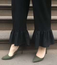 """""""I always pair a more slender heel with any wider-leg pant shape, like these party-ready ruffles. It balances the volume, plus the heel and pointed toe give my shorter frame a more elongated appearance."""" — Gina Marinelli"""
