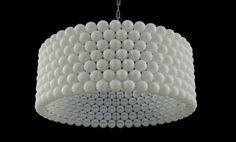 How neat is this. Wonder if I can find that many Ping Pong balls. Ping Pong Ball Lamp by Diaz Kleefstra is made of 315 balls!