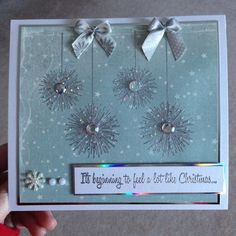 Bauble sparkly card , embossed then glittered , its beginning to feel a lot like christmas
