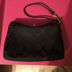 Coach wristlet. Black logo coach wristlet with gold hardware.     Twist lock closure. One inside pocket, great for credit cards and drivers license. Can be worn as a wristlet or a small tiny bag. Coach Bags Clutches & Wristlets