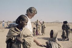 2009 Nansen Award to Ted Kennedy | The Senator Edward M. Kennedy has a smile and a handshake for an unidentified young refugee in an eastern Sudan camp in 1984. Many of the refugees had walk for a week to reach the camp from Eritrea. Credit: AP Photo/Robert Dear
