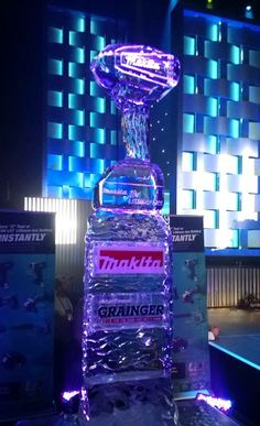 Makita drill ice sculpture with their logo and the Grainger logo done during a live exhibition.