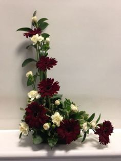 Flowers used: maroon Gerber Daisies and white mini carnations. Ikebana Arrangements, Funeral Floral Arrangements, Ikebana Flower Arrangement, Church Flower Arrangements, Beautiful Flower Arrangements, Beautiful Flowers, Altar Flowers, Church Flowers, Deco Floral