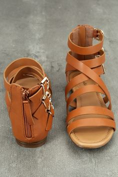 """Stomp through the festival fields in your new Neria Tan Gladiator Sandals! Vegan leather straps cross over a peep-toe and climb to a cute, gladiator silhouette with adjustable gold buckles at the outstep. 3.5"""" heel zipper."""