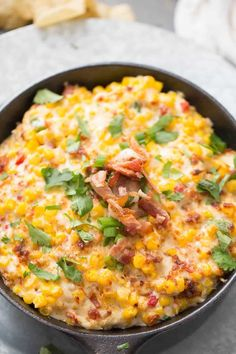 This hot corn dip recipe might be the best thing ever! You can't ever go wrong with hot melted cheese and bacon!
