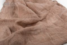 Beige washed linen fabric. Great for making shawls and curtains.