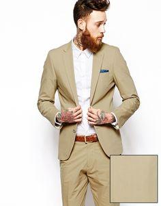 Anzugjacke von ASOS glatter Baumwoll-Popelinestoff eingekerbtes Revers Knopfleiste mit zwei Knöpfen Futter mit Innentasche funktionale Taschen optionales, eingearbeitetes Einstecktuch schmale Passform, sitzt eng am Körper Chemisch reinigen 100% Baumwolle Model trägt 40 Zoll/102 cm und ist 191 cm/6 Fuß 3 Zoll groß Lieferung im Kleidersack