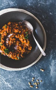 Tomato lentils, cooked in coconut milk with smoked paprika and canned crushed tomatoes. Cheap and delicious dinner! Bold flavors, vegan, gluten-free,