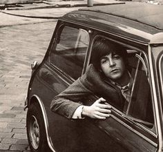 Paul McCartney in a Mini Cooper