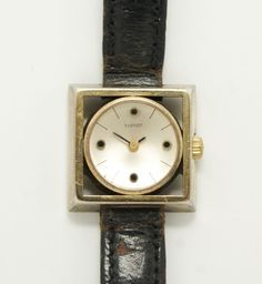 This is a wonderful vintage ladies wristwatch manufactured by Tissot of Switzerland in the 1960s. Rendered in fine 800 silver, this unusual gold washed watch case features a striking Mid Century Modern design.