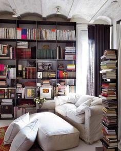 I especially like the vertical shelf on the right as a way to stack books that way and have it be reasonably easy to retrieve any book. And I love the way the ceiling is shaped as a contrast to all of the straight lines in the bookshelves.
