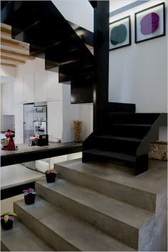 Polished concrete floors. Also this black metal staircase is nice.