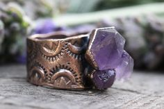 Raw Amethyst Ring Amethyst Cluster Ring Amethyst Jewelry Raw Crystals and Stones Raw Crystal Ring Natural Stone Ring Gemstone Ring Skeletal Amethyst Ring Size 8.25  This raw amethyst crystal cluster ring is gorgeously organic and rustic. It features one raw skeletal amethyst cluster inside of copper. The sturdy band has been hand stamped with a unique geometric pattern. It is like something worn by an ancient tribal queen! I created the ring with a technique called electroforming. Copper is…