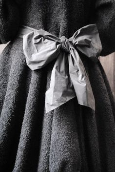 Add a great embellishment to the back of a simple dress, coat, sweater or jacket.  #gray. #fashion. #details