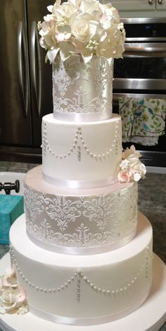 """Grand Island Mansion Wedding - Sugar Flowers, roses, hydrangeas, leaves, buds, filler flowers, luster finish, stencil, pearls.  Cakes covered in fondant!  Tiers are 12"""", 9"""", 6"""", 4"""" and approximately 5"""" tall finished.    I pre-marked the swags for easy pearl placement using the Wilton Cake Dividing Set (http://www.wilton.com/store/site/product.cfm?sku=409-806)"""