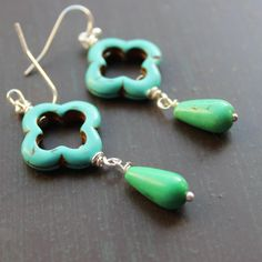 Turquoise blue quadrafoil cross beads paired with bright green howlite teardrops dangles. $8