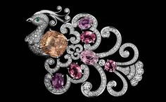 "CARTIER ""Bird of Paradise"" brooch with 20.22-carat pink Sapphire and six padparadscha Sapphires."