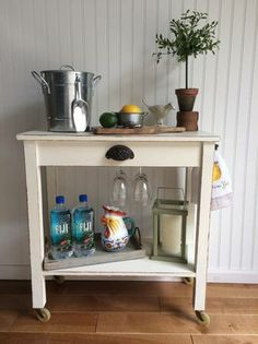 Make your own bar cart with a cute end table, paint and vintage hard ware! love it!