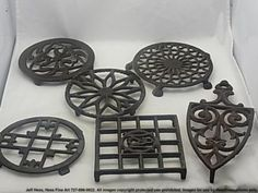 """I have over 30 of these Antique Iron Trivets. they were my mother's! They are the """"Border"""" on my kitchen wall!"""