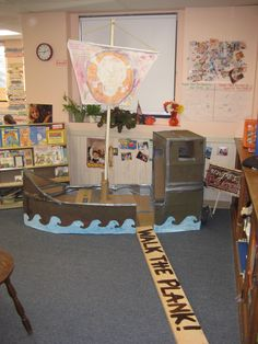 "I love this! We'd probably be making one every other year but who cares it's so cute! -- read How I Became a Pirate by Melinda Long and David Shannon -- Yes the sail moves up and down! And yes, there is a huge anchor in the back! I love the ""walk the plank"" and tape a shark fin or two around the plank and you're set!!"