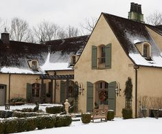 Steep-pitched roofs, arched windows, Cottage Shutters and courtyards were inspired by French architecture.