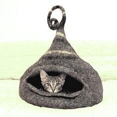 And I don't even have a cat anymore, but if I did, I'd get her one of these.   Cat bed / Cat cave / felted cat house / gray  ORDER by MajorLaura, $145.00