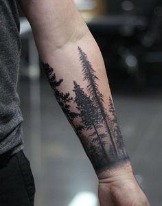 tatouage avant-bras paysage forestier