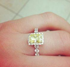 Canary diamond yellow diamond ring with diamond halo and shank