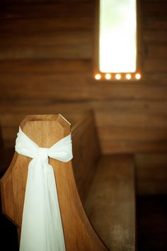 church pew decor - maybe we could do something simple like this except with different colored ribbons